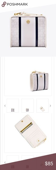 """Tory Burch Gemini Link Mini Wallet Water-resistant coated canvas; Pin-snap closure; 6 interior credit card slots, 2 bill pockets, 1 zipper pocket; Fits international currency; Height: 3.59"""" (9 cm); Length: 4.18"""" (10.5 cm); Behind the Gemini Link; Two is a significant number for Tory, from her twins to her zodiac sign. Seen on handbags, shoes, clothing and accessories, the double-link design celebrates life's dualities. Tory Burch Bags Wallets"""