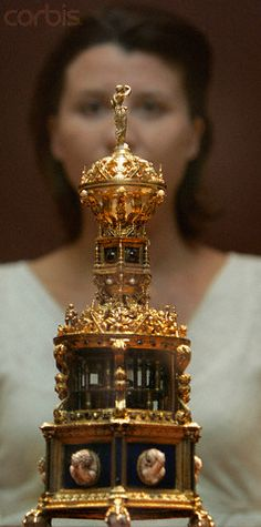 A gold clock salt owned by King Henry VIII made by a French goldsmith based on sketches by Hans Holbein the Younger.