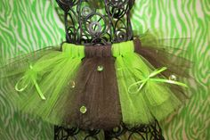 Brown and green tutu with green ribbon and jewels