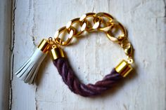 chunky curb link chain bracelet with rope and white leather tassel