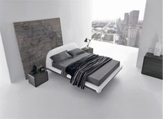 Minimalist bedroom with great view of the cityscape.