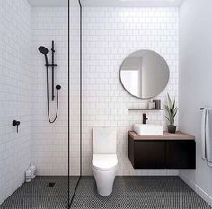 Znalezione obrazy dla zapytania black and white tiled shower bathroom