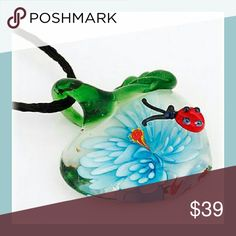 Flower Apple Ladybug Glass Pendant This adorable glass pendant necklace is in the shape of an apple with green leaves with a light blue and white colored flower and an adorable little red and black ladybug on top. This is a unique and one of a kind piece and is sure to be a conversation starter.  Great gift for yourself or for a teacher, nature lover, Christmas, Birthday, Friend. Jewelry Necklaces