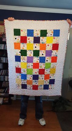 Light rainbow fun.  Made with charm squares.  Measures approximately 40 x 50.