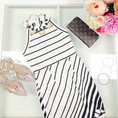 LAST ONE!Black and white asymmetric dress Super cute asymmetric  stripe dress. 96% polyester and 4% spandex. By tea and cup. Last one! Super cute! Comfortable too Tea n Cup Dresses Asymmetrical
