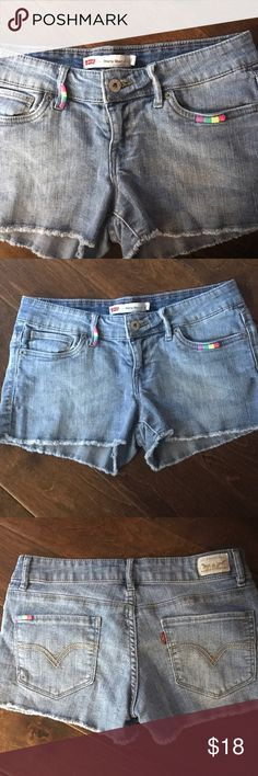 "🎉 Distressed Denim Jean Shorts Levi's Size 5 🎉 Cute distressed frayed denim shirts from Levi's. Cute embroidered rainbow rickrack accent on front. Size 5 Juniors. Waist across 15"". Inseam approx 2"". Fabric does have some stretch. Levi's Shorts Jean Shorts"