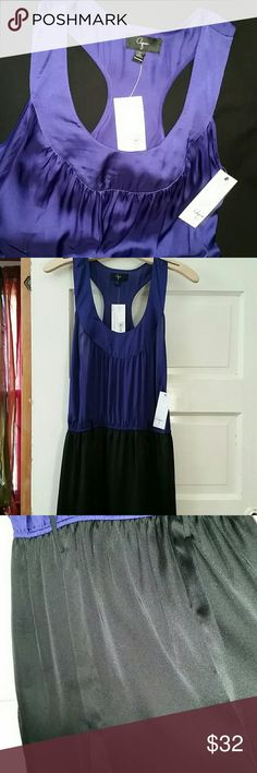 """NWT dress AQUA dress from Bloomingdales. Royal purple and black. Sleeveless, racer-back purple top. Elastic middle with belt hoops  (belt is missing). Skirt is 18"""" long and lined. Dress flows beautifully,  looks like silk, but is polyester.  New never worn. Aqua Dresses"""