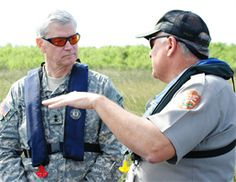 During an airboat ride through the Everglades, Dan Kimball, superintendant of Everglades National Park, discusses Everglades restoration efforts with Maj. Gen. Michael J. Walsh, Deputy Commanding General for Civil and Emergency Operations for the U.S. Army Corps of Engineers, during his visit to south Florida Jan. 23.