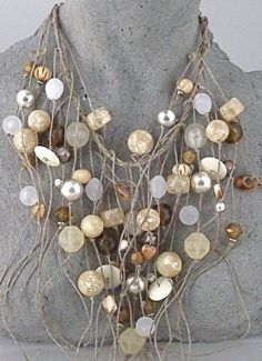 Necklace |  Teresa Goodall.  Resin, bone and silver beads on linen cord.