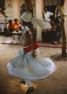 a dancer performs during a Kohomba Kankariya healing ritual in Kekirawa, central Sri Lanka