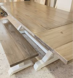 6 ft farmhouse table that extends to 8ft.  This table is stained in our custom weathered stain.