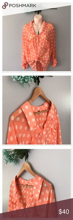 Free People sheer blouse 🌺NWOT Get ready for spring with this beautiful Free people blouse! A peachy color with cream poke dots. NWOT. The sleeves can be adjusted and the style is high/low . Free People Tops Blouses