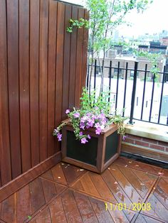 small terrace with  fence  deck  and  planters