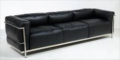 """This Sofa LC3 Grand Confort was designed by Le Corbusier, Pierre Jeanneret and Charlotte Perriand in 1928. Generally referred to as """"cushion basket',  It was edited by Cassina in 1965, it is composed of six independent cushions in black leather, padded and belted with a polished chrome tubular structure."""