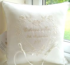 Image from http://www.goldstitch.co.uk/weddingcushions/weddingpillows/floralheart11.jpg.