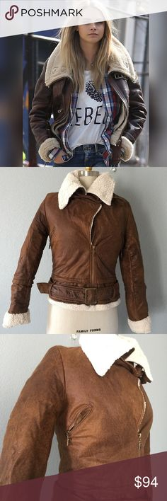 Aviator Jacket Talk about Fall Chic, this amazing Faux leather aviator jacket is just amazing. Super soft outside faux leather, just like Sheep skin, you would never know the difference, and the inside Faux wool just Amazing.2 belts at neck, belt at waist . Size S can fit a 6-8 retail &208 + tax.  ✅ will bundle ✅ ✅ all reasonable offers will be considered  No Trading  Poshmark rules only‼️ Measurements taken laying flat Ⓜ️ chest 19 Ⓜ️Length 22 Ⓜ️sleeves 25 Mol-V Jackets & Coats Utility…