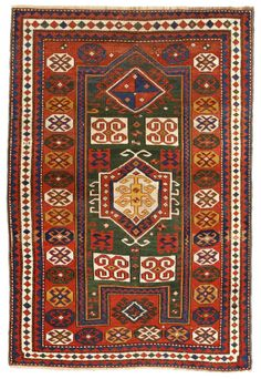 Antique Kazak Rug, Caucasus, 1900s - This vibrant Kazak rug features an unusual medallion decorated with irregular latch hooks & two double ram's horn motifs arranged in a cruciform pattern. These graphic motifs that symbolize power & other auspicious traits create a dominant theme across the central medallion of this traditional Kazak carpet from the Caucasus. Wide red borders decorated with symbolic bereket motifs surround the irregular field... Size: 3 ft 8 in x 5 ft 4 in
