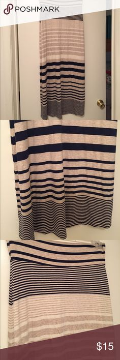 Navy striped maxi skirt Super comfortable maxi skirt! The stripes are navy blue and beige with some white also. May run a little small? Skirts Maxi