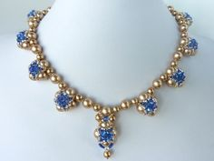 FREE beading pattern for elegant evening necklace with stunning Swarovski crystals set around gold pearls. Pattern includes matching earrings.
