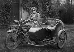 Classic motorcycle and sidecar with lady pilot.