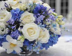 have a bride looking at blue and white flowers for her wedding these are lovely