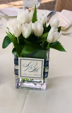 White Tulip Centerpiece with monogram - Do the same but with different flowers - perhaps hydrangeas