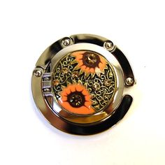 Designer Collection Embossed Mirrored Purse Hook, Sun Flowers $11.95