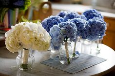 Bridesmaid's bouquets in vases during reception. (My approach? Mason jars?)