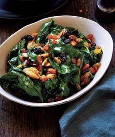 Hearty prewashed spinach goes from refrigerator to star of the sideboard in just 15 minutes. Get the recipe for Wilted Spinach With Raisins and Pistachios.