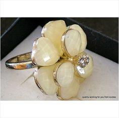 Costume jewellery ring and cream stones