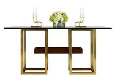 """Madeleine conversion table, mahogany finished in Lacoste walnut with brass hardware and a glass top, shown as a dining table (30.25"""" h. x 64"""" l. x 42"""" w.) the base and top can be reconfigured to serve as an 18""""-high cocktail table, $8,970"""