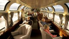 Passengers in Amtrak Coast Starlight  train lounge and observation car.