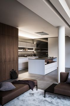 SieMatic kitchen - stunning combination of dark hardwood and white cabinetry with their innovative drawer organisation designs...x
