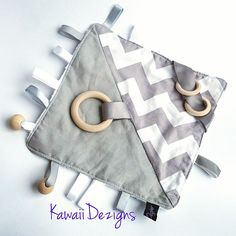 GREY CHEVRON SENSORY ACTIVITY BLANKET NEUTRAL UNISEX FABRIC ZIG ZAG WOODEN RING BEADS WOOD TEETHER TEETHING CHEW CRINKLE CRACKLE SOUND TAGGY TAG RIBBON BY KAWAIIDEZIGNS