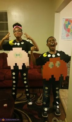 Janel: Sonaiyu and deandre are the pac-man ghosts from one of the best video games of all time. PAC-MAN! Costumes were made with cardboard and spray paint. We used a clear...