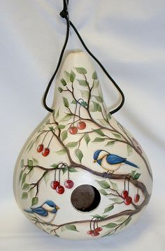 My chickadees and red cherries are painted on a martin house gourd. It is 10 1/2 tall and 24 around. Hangs from a black nylon cord with 3 drainage