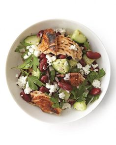 Tear a toasted pita into pieces and toss with red kidney beans, feta, and cucumber in this tasty salad, Wholeliving.com #meatless #salads #vegetarian