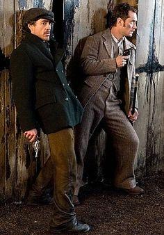 "Robert Downey Jr. as Holmes and Jude Law as Watson in ""Sherlock Holmes"" (2009)."