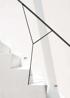 The staircase to the uppermost level is white Corian.  Photo: Michael Moran