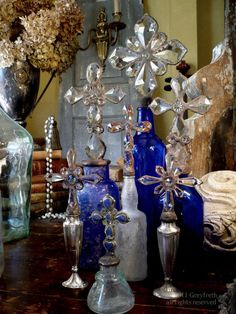 I love crosses . . these blue bottles are beautiful!