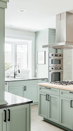 """( Top ) Green Kitchen Cabinets - """" Good for Kitchen? """" Get Ideas. Transitional Light Mint Green Kitchen Cabinets With Wooden Countertop Another light mint green kitc Kitchen Cabinets Grey And White, Green Cabinets, Kitchen Cabinet Colors, Light Kitchen Cabinets, Painted Kitchen Cabinets, Kitchen Windows, Dark Cabinets, Cupboards, Mint Green Kitchen"""