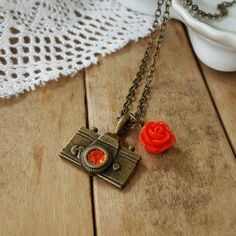 Check out this item in my Etsy shop https://www.etsy.com/listing/260736228/camera-necklace-antique-bronze-camera