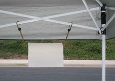 hang a paper towel roll using a bungee cord from the tent struts. | 41 tailgating hacks that are borderline genius