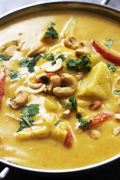 Saucy coconut curry chicken with sweet red peppers, tender potatoes, and crunchy cashews made right in your crockpot! | Creme de la Crumb