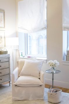 arielle charnas' nursery reveal. featuring our shelter swivel glider and parisian side table.