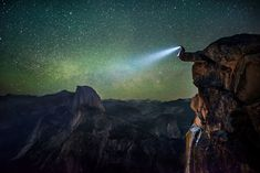 Man with headlamp sitting on ledge at Glacier Point at Yosemite National Park. Photo: Christian Adam Fernandez/Caters News