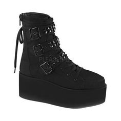"""Be alternative and unconventional in these platform lace-up ankle boots with with pyramid-studded buckle straps and interchangable laces. Back zip closure. Heel Height: 3"""" Shaft Height: 7.5"""" Origin: I"""