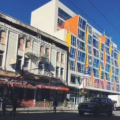 22nd and mission historical building set to flames contrasting with new development