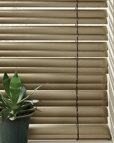 Close Up Of Hunter Douglas Reveal Gold Aluminum Blind With The Nested Slats These