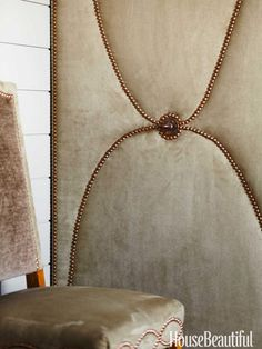 A dining room door is upholstered in faux suede.